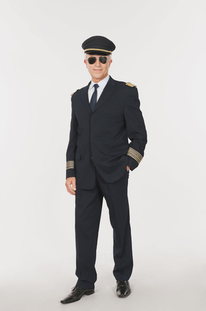 airline pilot: Close up of senior flight captain standing on white background