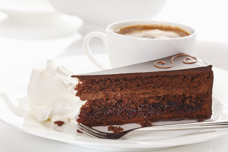 cake: Slice of Sacher cake in plate with coffee Stock Photo