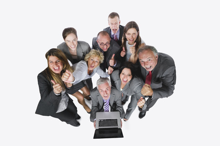 Business people looking at laptop against white background elevated view photo