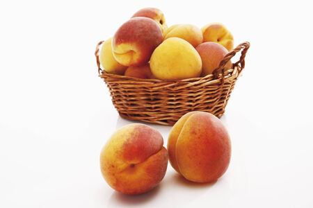 Apricots in a basket photo