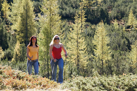 woman hiking: Two women in mountains, nordic walking