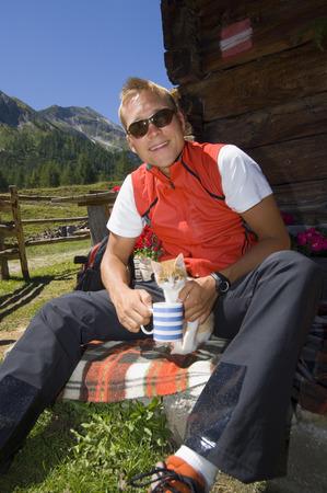 Austria, Salzburger Land, blonde man with cat photo