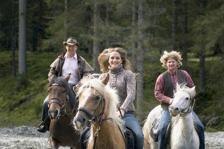 Austria, Salzburger Land, Altenmarkt, Young people riding horses