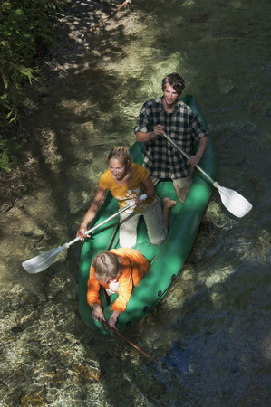 Austria, Salzburger Land, Family on a creek, canoeing, elevated view photo