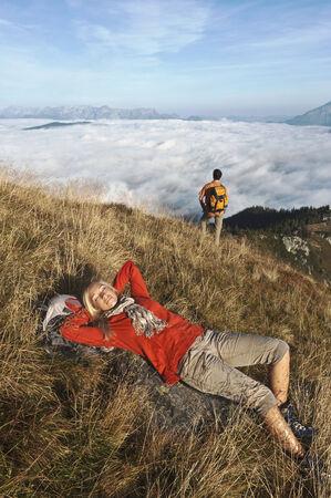 steiermark: Austria, Steiermark, Reiteralm, Couple in mountains, woman lying in grass