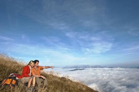 steiermark: Austria, Steiermark, Reiteralm, Hikers in mountains, man pointing