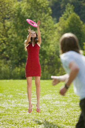 flying disc: Girl catching flying disc