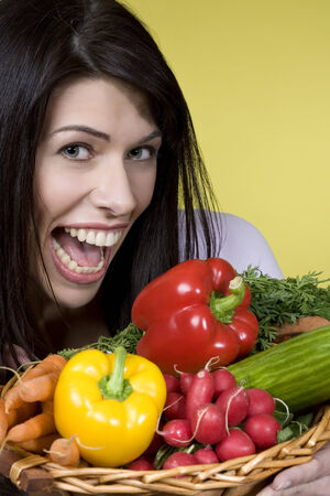 fooling: Dark-haired woman with vegetables, fooling around, portrait