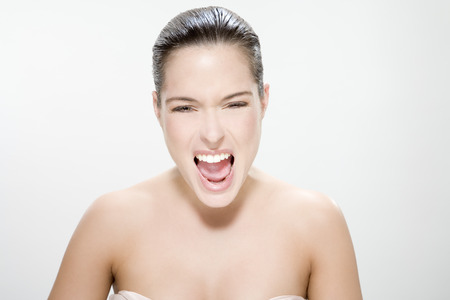 Young woman yelling, portrait photo
