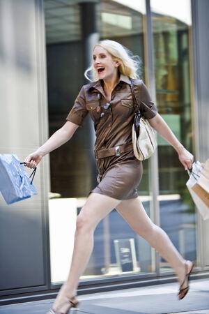 Young woman going shopping photo