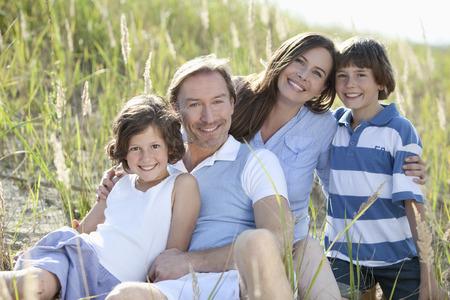 Germany, Bavaria, Family enjoying together, smiling, portrait photo