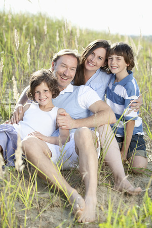 Germany, Bavaria, Family enjoying together, smiling, portrait