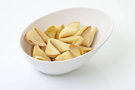 Fortune cookies in bowl on white background