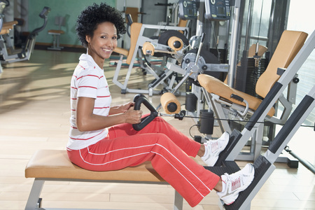 close up woman: Germany, Bavaria, Woman exercising in gym, portrait