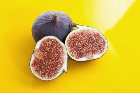 elevated view: Whole and sliced figs, elevated view