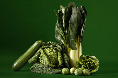savoy cabbage: Leafy vegetables against green background