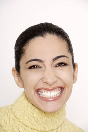slicked: Young woman clenching teeth, portrait