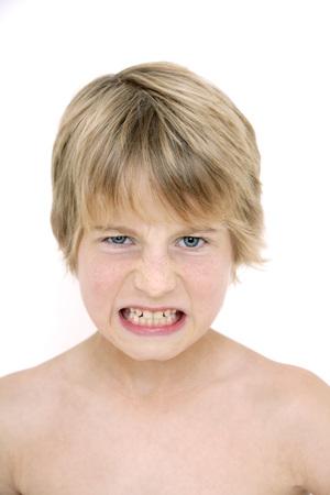 gritting: Little boy gritting his teeth, portrait