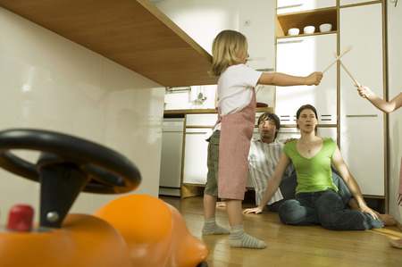 imitating: Family in kitchen, playing with children Stock Photo