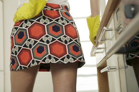 Woman wearing mini skirt and rubber gloves photo