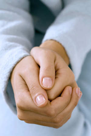 clasping: Woman clasping hands