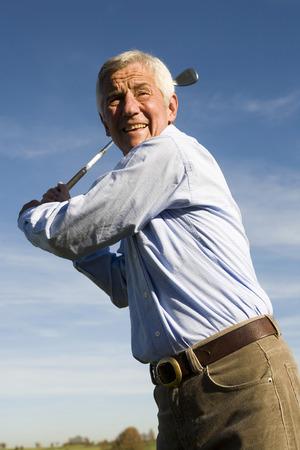 senior adult man: Senior adult man holding golf club