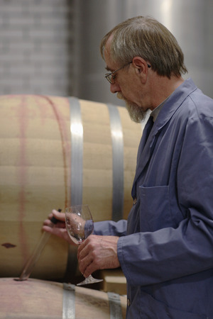 wine testing: Man testing wine from cask