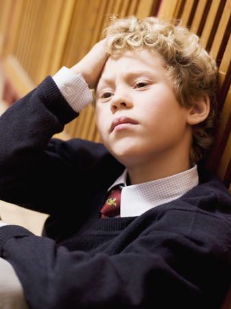 overstress: Boy leaning on locker