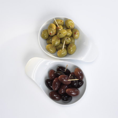 Olives in bowls on white background photo