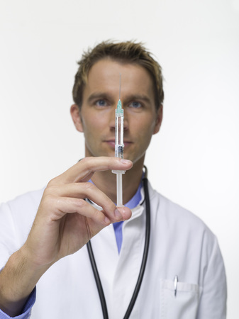 Male Doctor with Syringe, portrait photo