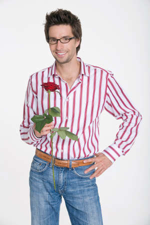 Young man holding a rose Stock Photo