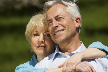 Germany baden wurttemberg tubingen senior couple embracing smiling photo
