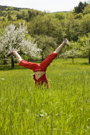 baden wurttemberg: Germany baden wurttemberg tubingen child doing handstand in meadow Stock Photo