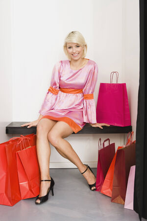 Young delighted woman in shops fitting room Stock Photo