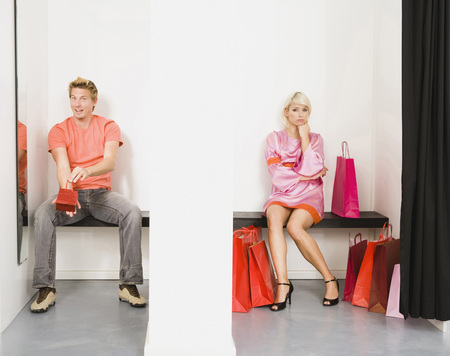 Couple sitting in shops fitting room