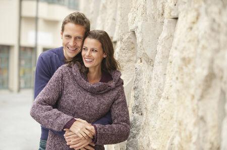 couple cuddling: Germany, Bavaria, Munich, Couple embracing