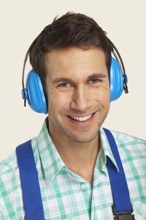 ear muff: Man wearing ear muff smiling close-up Stock Photo