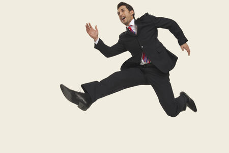 Businessman jumping in air smiling. photo
