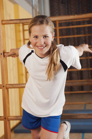 wall bars: Girl hanging from wall bars