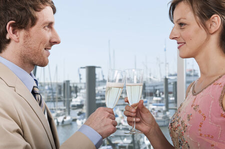 mesmerized: Germany, Hamburg, Man and woman toasting glass smiling