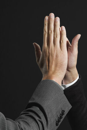 businesspersons: Businesspersons giving high five each other