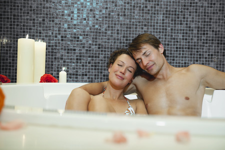 Italy, SouthTyrol, Couple having romantic bath in hotel