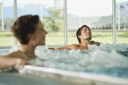 Couple having bubble bath in hotel photo