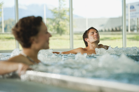 jacuzzi: Couple having bubble bath in hotel