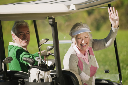 golf bag: Italy, Kastelruth, Mature couple in golf cart