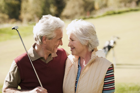 Italy, Kastelruth, Mature couple in golf course photo