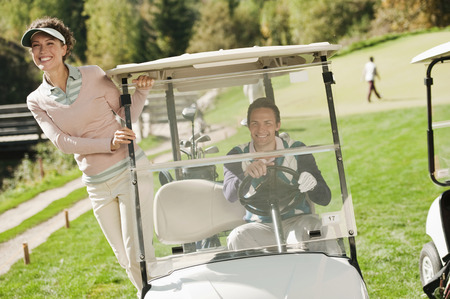 golf cap: Italy, Kastelruth, Couple in golf cart