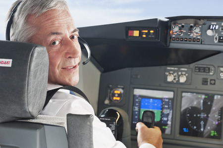 Pilot driving airplane in cockpit photo