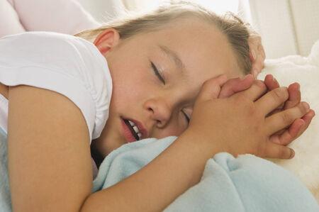 Young girl sleeping on an airplane on airplane photo