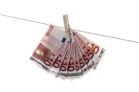 10 Euro bank notes hanging on clothesline Stock Photo